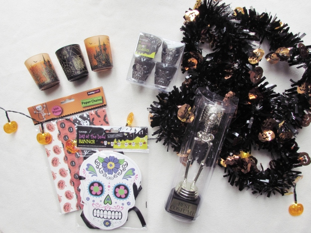 pumpkin tinsel paper chains and trophy from hobbycraft sugar skull banner and shot glasses from asda halloween candles from bm bargain stores